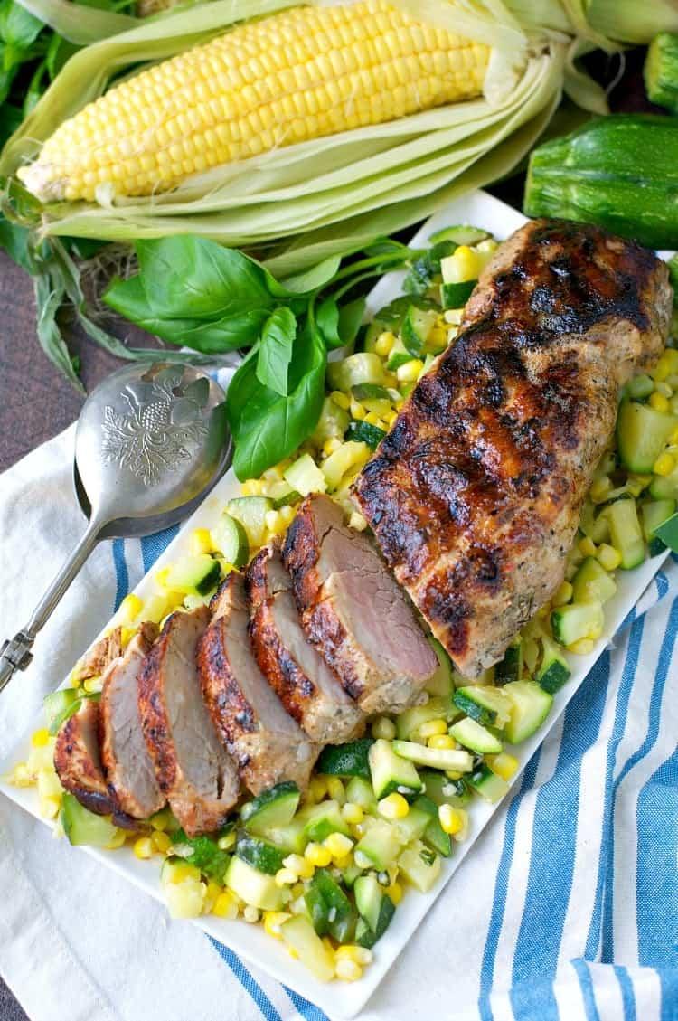 An overhead shot of boneless pork tenderloin with vegetables
