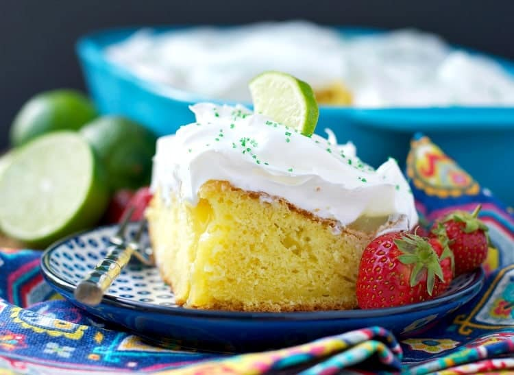 Margarita Poke Cake with fluffy cool whip frosting!