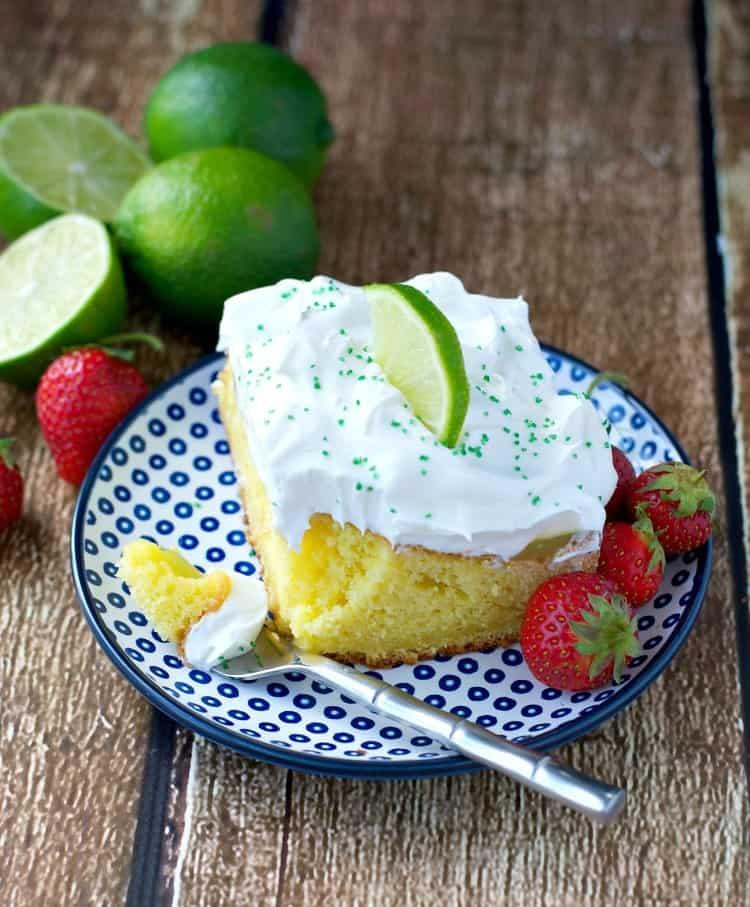 Use a box of cake mix to make this boozy cocktail inspired Margarita Poke Cake!