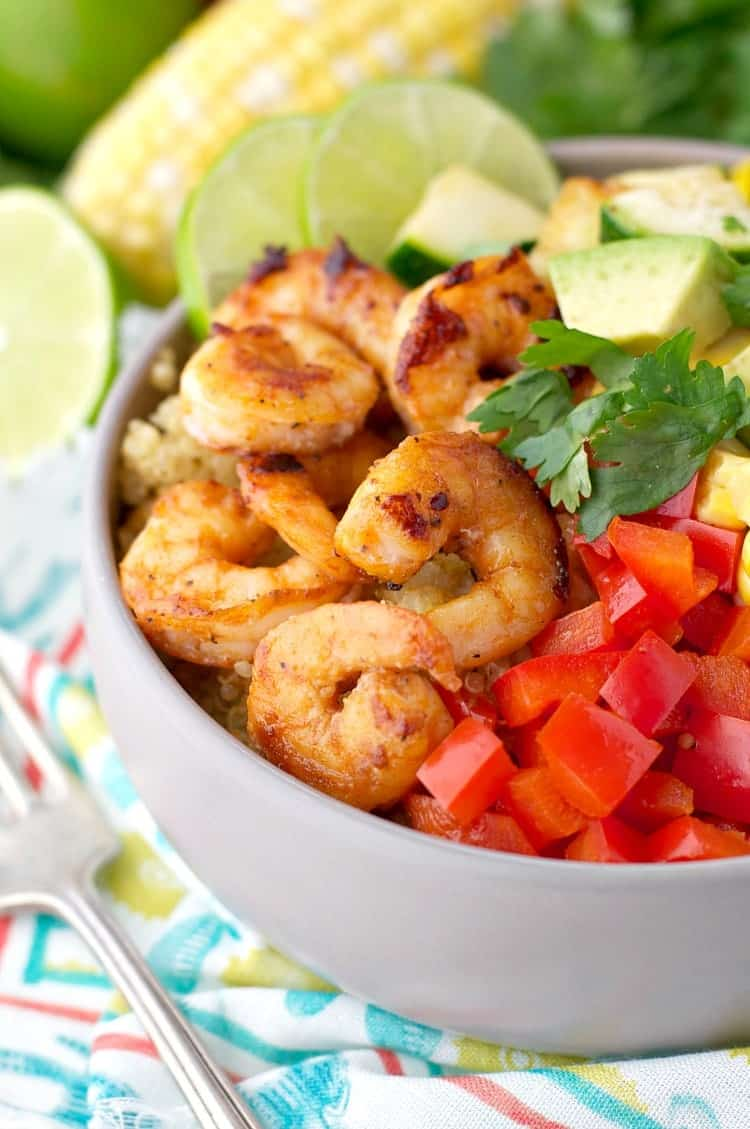 A side shot of marinated shrimp in a bowl