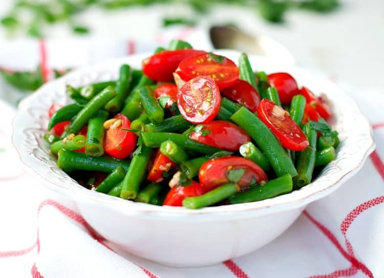 Enjoy all of summer's best produce with this Simple Italian Green Bean Salad! It's an easy and healthy side dish that can be prepared in advance and served at picnics, potlucks, and cookouts all season long!