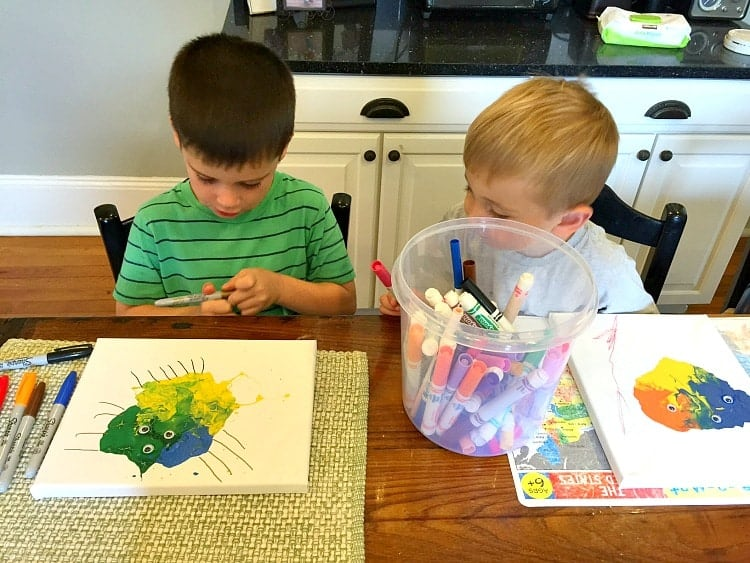 Kids decorating blow paint monsters are a fun art idea!