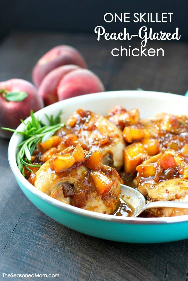 A close up of peach glazed chicken in a blue bowl