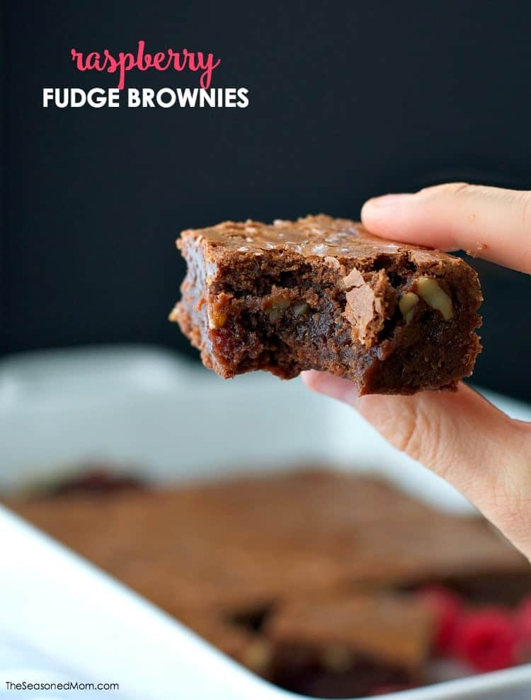 These made-from-scratch Raspberry Fudge Brownies are rich, chocolatey, and studded with crunchy walnuts. A center layer of raspberry preserves gives the dessert bars a moist, sweet, and juicy filling that is irresistible!