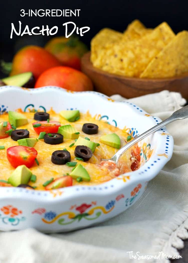This 3-Ingredient Nacho Dip is a quick and easy appetizer for all of your celebratory occasions! Whether you're hosting a football tailgate, a family birthday, or just a night in with friends...spend less time in the kitchen with this simple cheesy party snack!