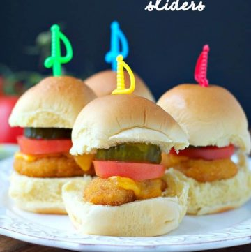 Three chicken nugget sliders on a white plate