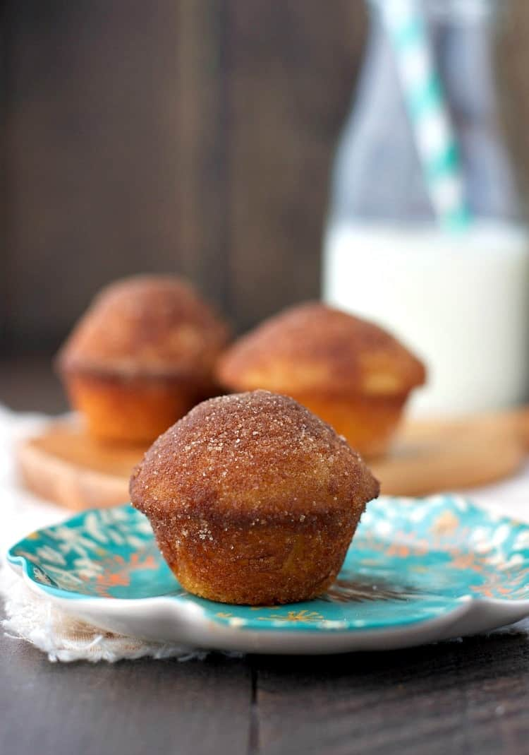 A close up of cinnamon sugar puff muffins on a blue plate
