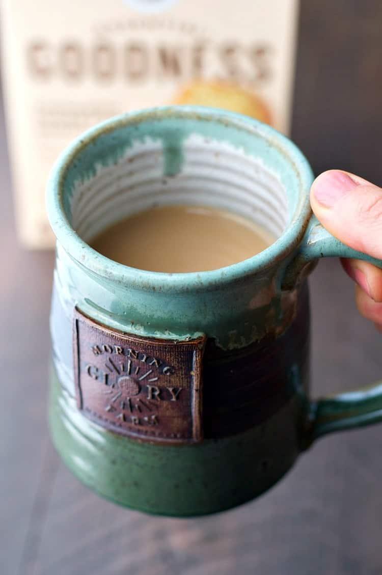 A close up of a green mug of tea