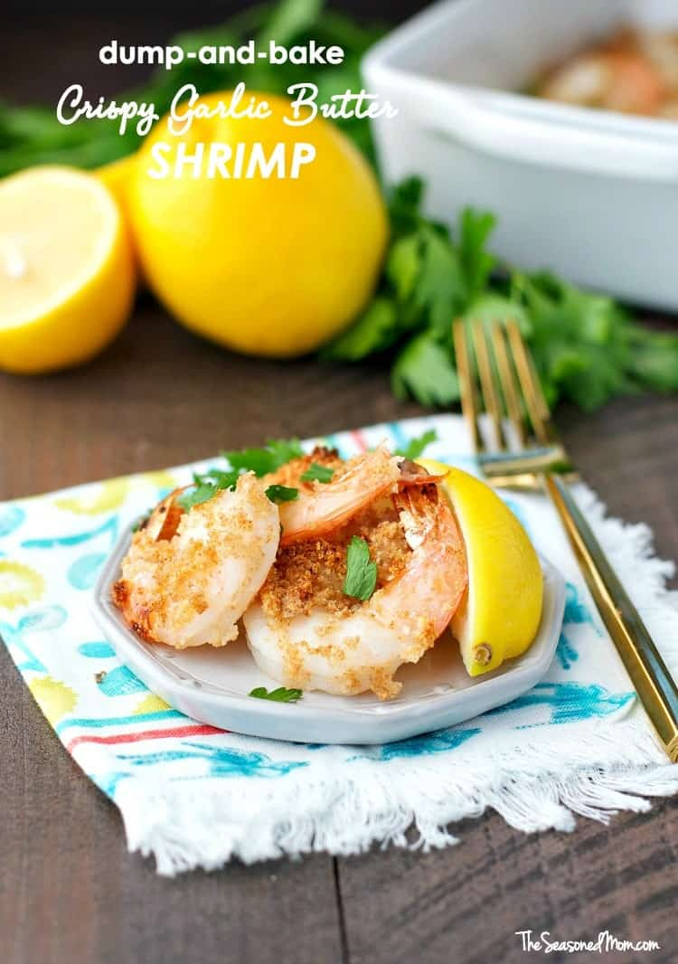 Crispy garlic butter shrimp on a plate with a wedge of lemon