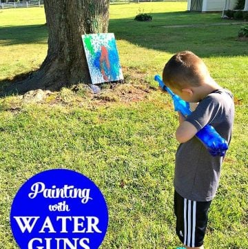 Painting with Water Guns is fun target practice activity for kids!