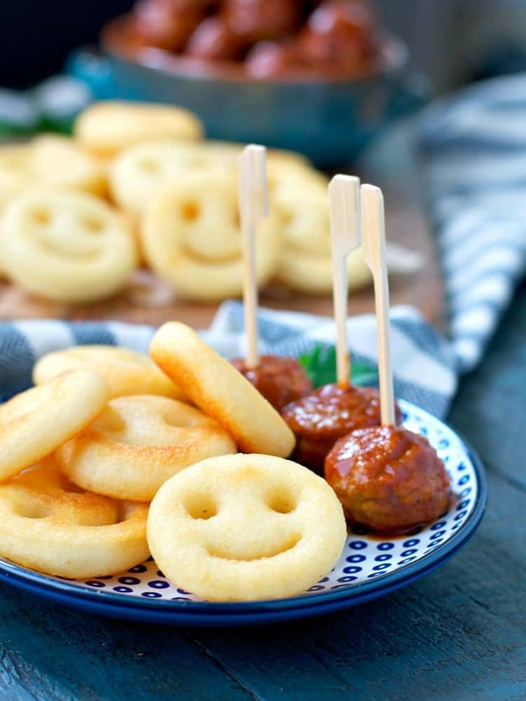 Slow Cooker Meatballs on a plate with smiley face potatoes