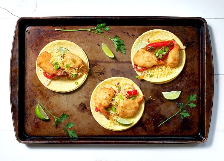 Three Crispy Shrimp Fajitas on a sheet pan