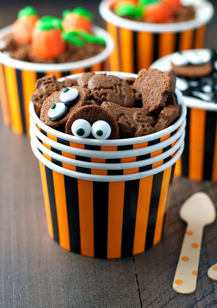 A close up of Halloween yogurt cups with little halloween cookies on the top