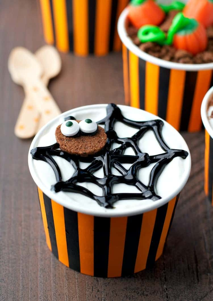 A close up of halloween yogurt cups made into a spider web shape