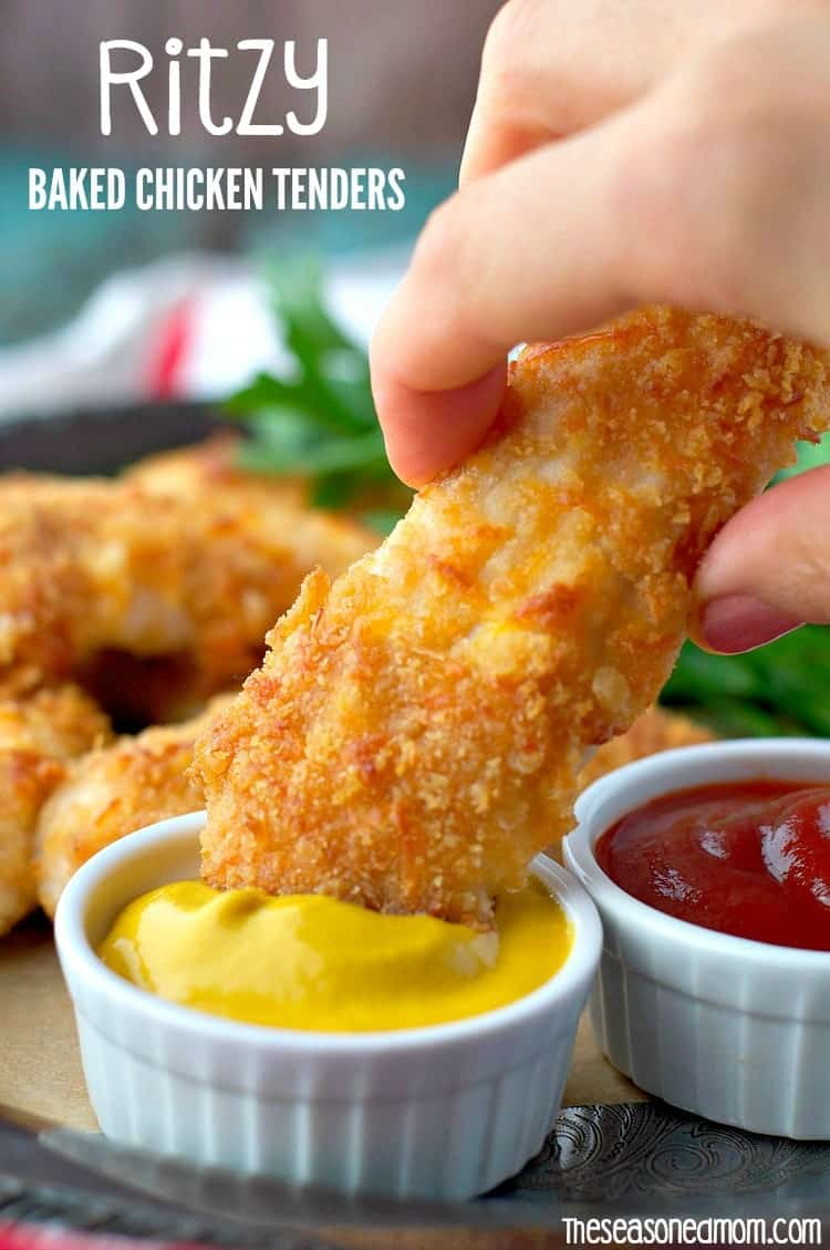 A close up of baked chicken tenders getting dunked into mustard