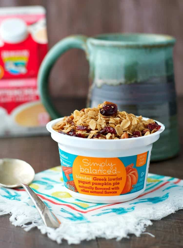 A photo of a yogurt topped with pumpkin spice granola