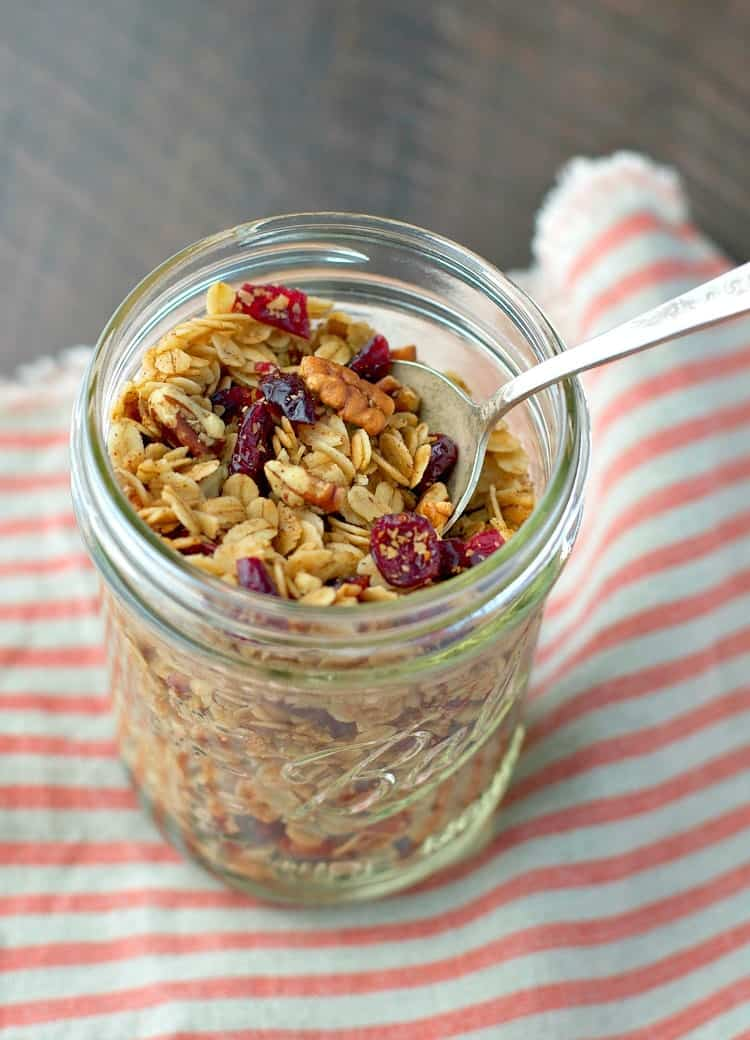 An overhead shot of pumpkin spice granola in a glass jar
