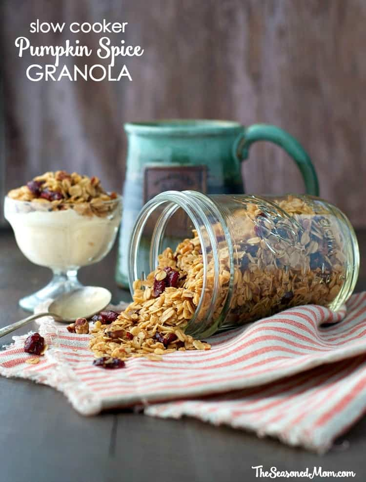A photo of pumpkin spice granola in a mason jar sitting on a work surface