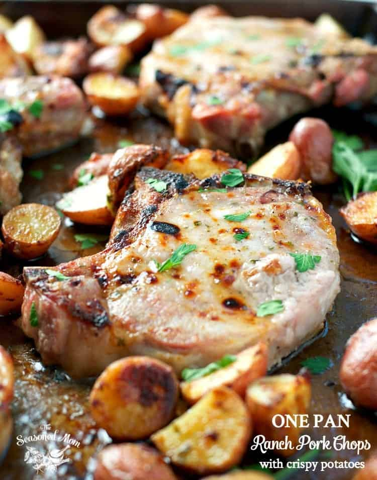 A close up of ranch pork chops with potatoes