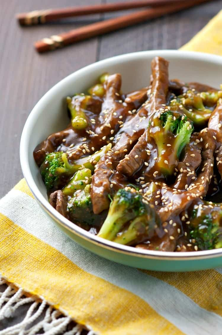 Mongolian beef in a bowl with broccoli and sesame seeds sprinkled on top