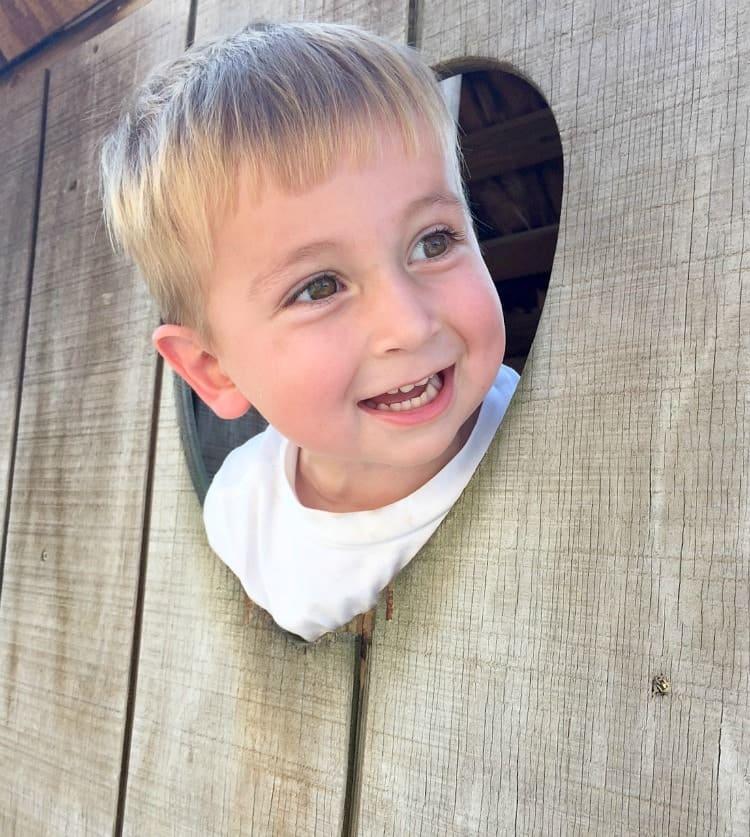 A small boy playing outside