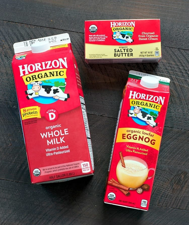 An overhead shot of horizon whole milk, egg nog and butter used for making cranberry bread