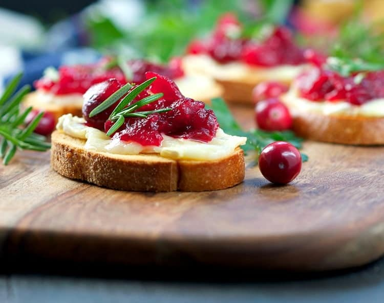 These Easy Cranberry Brie Appetizers are a quick, make-ahead party food to add to your holiday table -- and they're ready in less than 30 minutes!