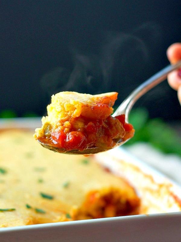 Close up shot of spoonful of Barbecue Chicken Cornbread Casserole