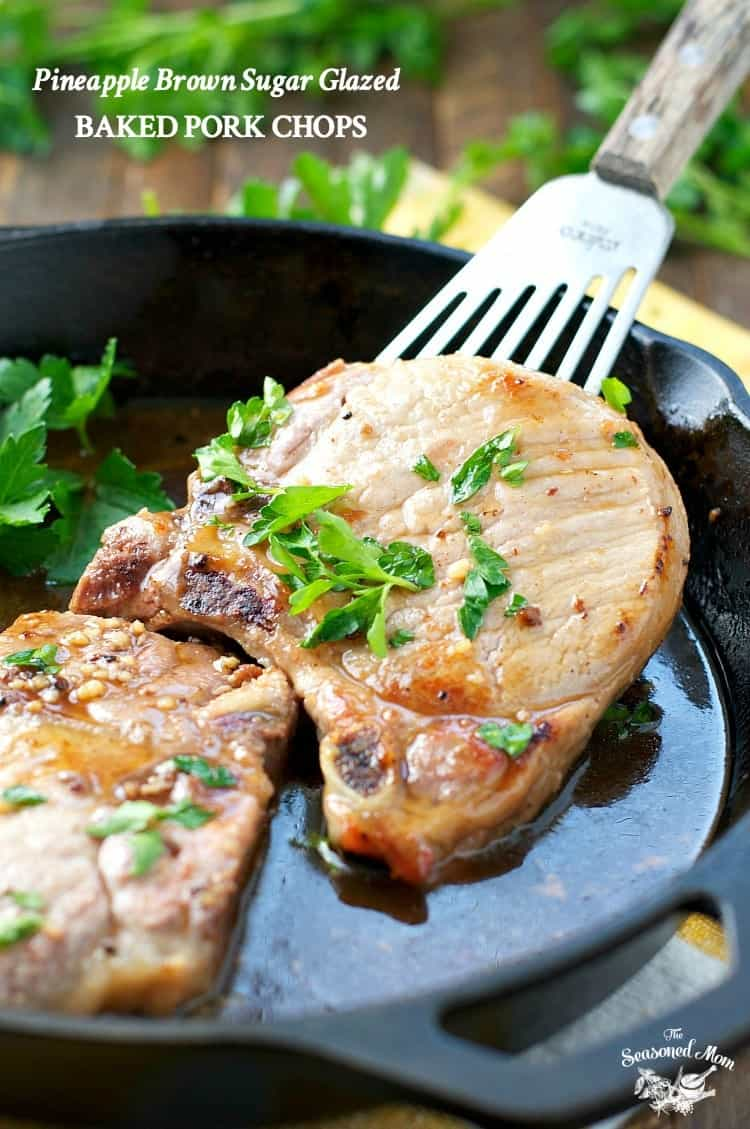 A close up of brown sugar pork chops in a skillet with a spatula
