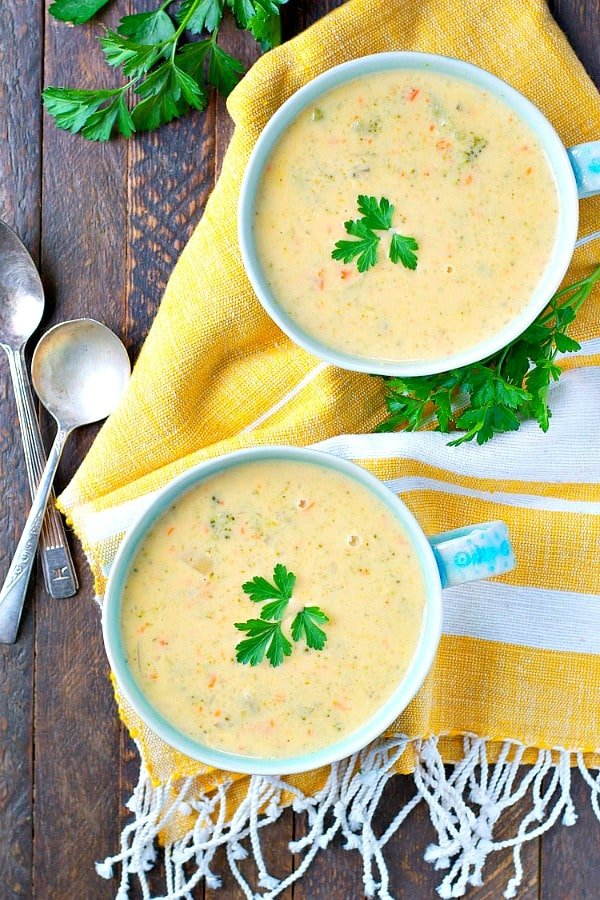 Overhead shot of two cups of Copycat Panera Broccoli Cheese Soup