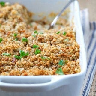 Close up side shot of chicken and stuffing casserole in a white dish