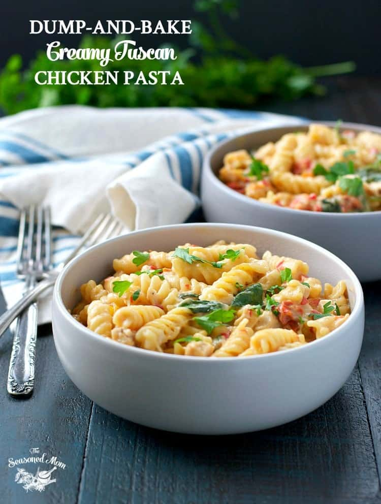 A bowl of Creamy Tuscan Chicken pasta topped with herbs