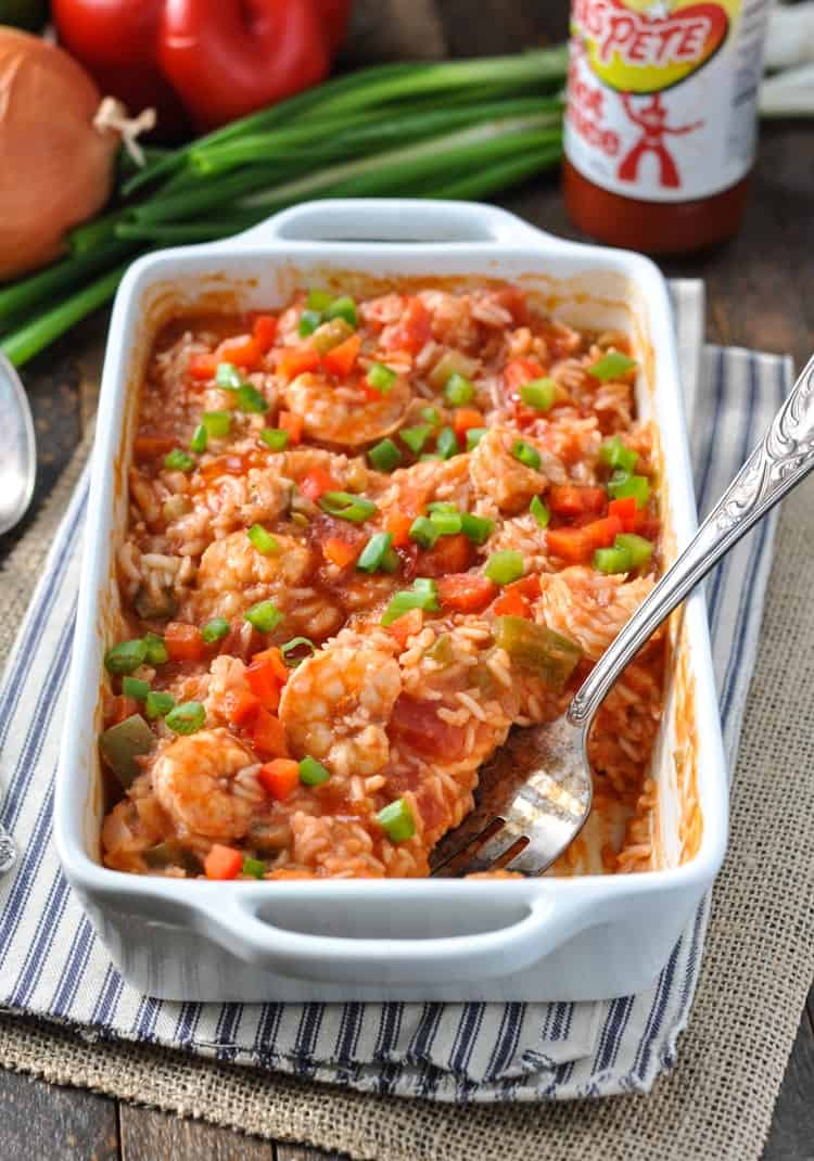 Shrimp Etouffee with rice in a large white baking dish