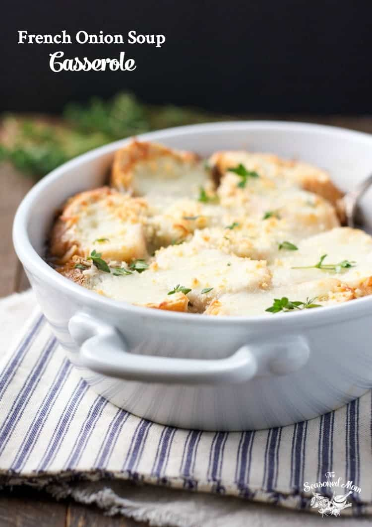 A French onion soup casserole in a white dish topped with cheese