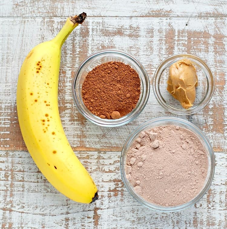 An overhead shot of ingredients to make a chunky monkey smoothie