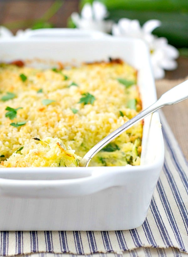 Zucchini Casserole in a baking dish garnished with fresh parsley