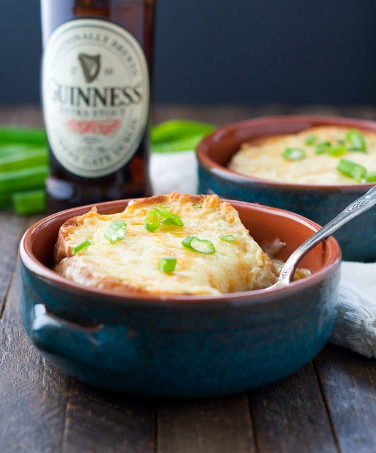 Bowl of Guinness Irish Soup with fresh chives and cheese toast on top