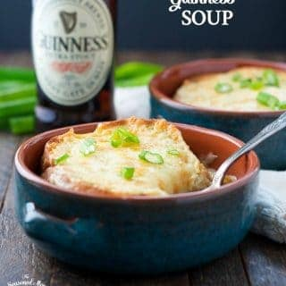 Guinness Irish soup in a bowl with a bottle of guinness in the background