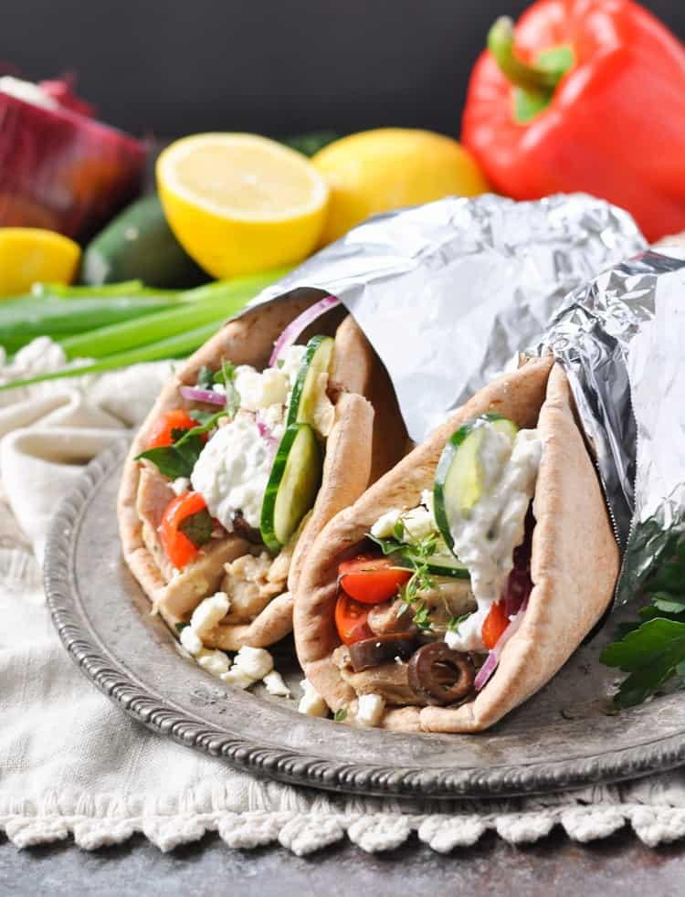 Slow Cooker Greek Chicken Gyros on a plate wrapped in foil