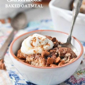 A close up image of healthy baked oatmeal in a bowl topped with cream