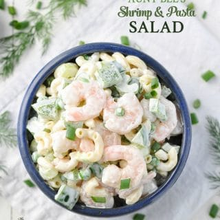A shrimp and pasta salad in a bowl with a creamy dressing