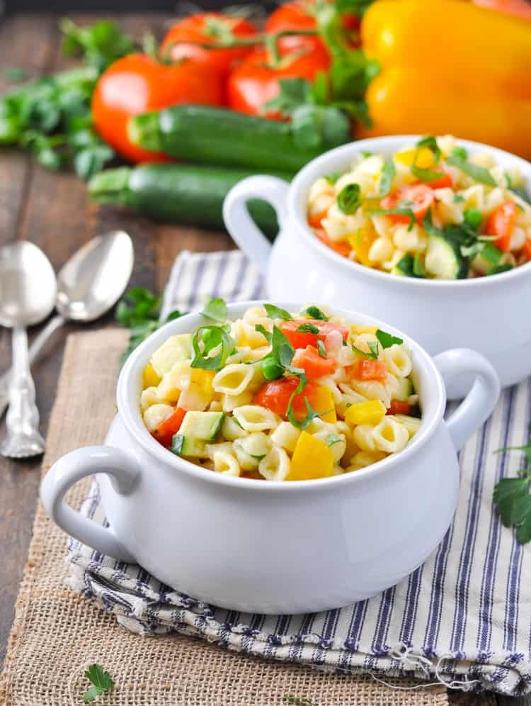A close up of Creamy Pasta Primavera in a white bowl