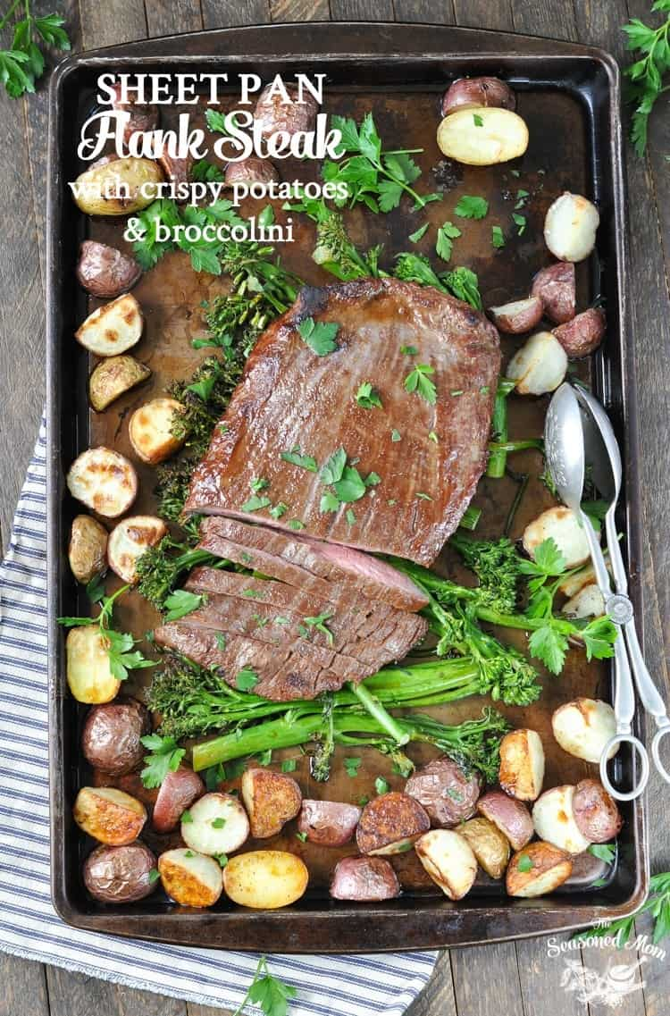 An overhead shot of sheet pan flank steak on a tray with potatoes