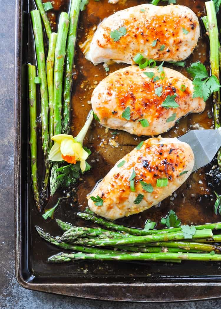 An overhead shot of honey apricot chicken with asparagus