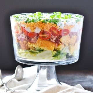 A layered southern cornbread salad in a glass dish