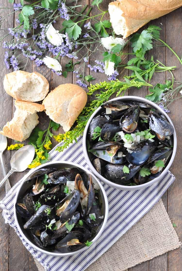 An overhead shot of Steamed Mussels in Garlic and Herb Wine Sauce