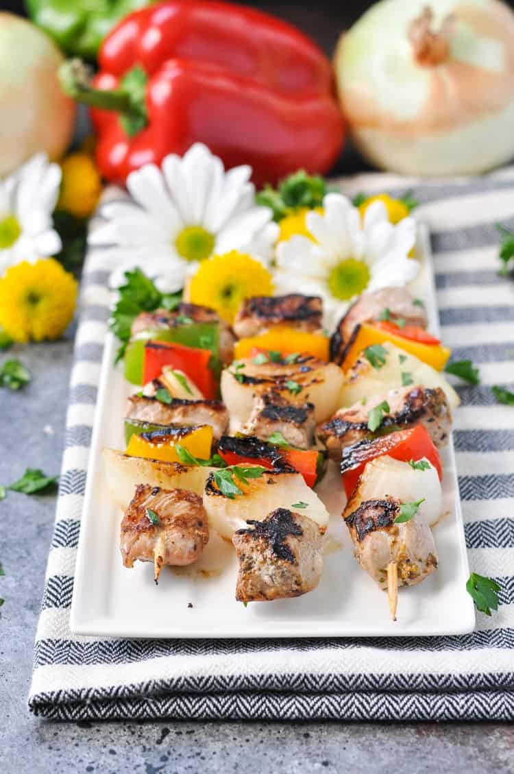 Garlic & Herb Grilled Pork Tenderloin Kabobs on a white plate