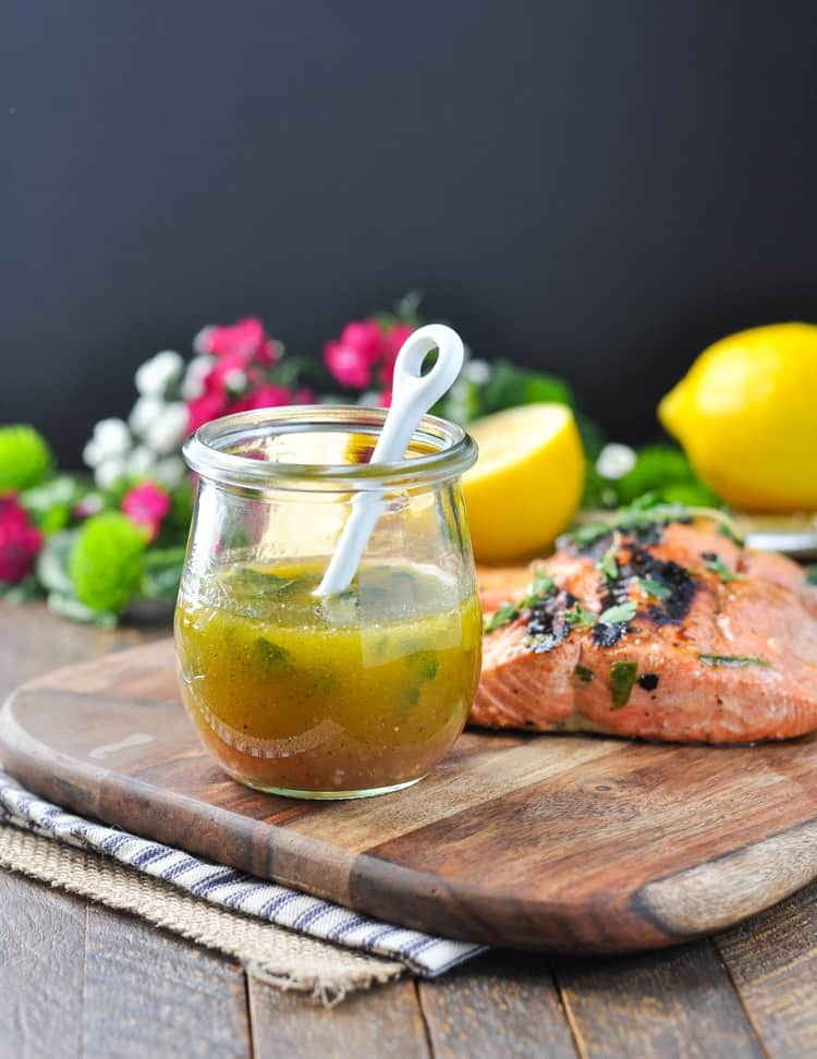 Garlic and Herb Salmon Marinade in a glass jar with a spoon