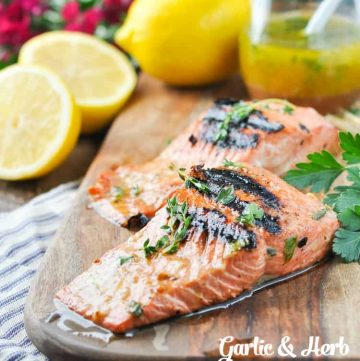 Salmon marinade on a salmon fillet sitting on a wooden board