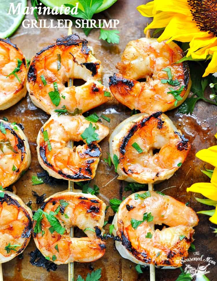 An overhead shot of Marinated grilled shrimp on a baking tray